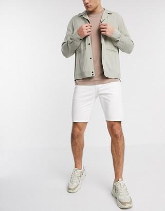 ASOS DESIGN skinny denim shorts in white