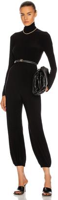 Norma Kamali Turtleneck Jog Jumpsuit in Black | FWRD