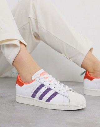 adidas x Girls are Awesome Superstar trainers in pink and metallic