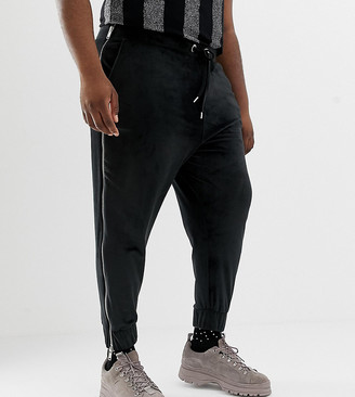 Asos DESIGN x LaQuan Smith Plus tapered velour jogger with side zips