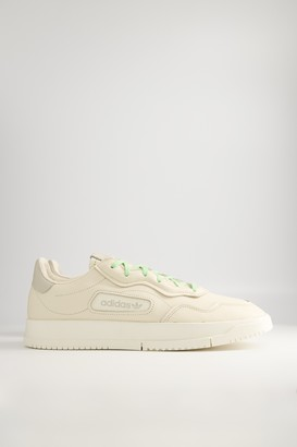 adidas Men's Pharrell SC Premiere Sneaker in Ecru Tint/White/Brown, Size 6 | Leather