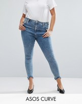 Asos High Waist Ridley Skinny Jean In Rula Mottled Wash With Arched Raw Hem