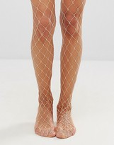 Asos Oversized Fishnet Tights In Peach