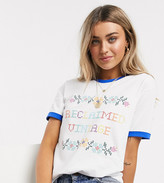 Reclaimed Vintage inspired ringer t-shirt with floral cross stitch print in white