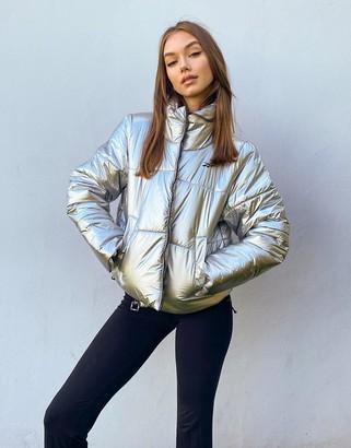 Reebok Training puffer jacket in silver