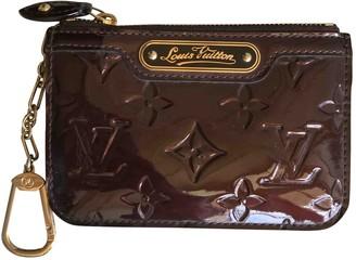 Louis Vuitton Burgundy Patent leather Purses, wallets & cases