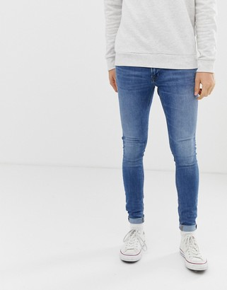Jack and Jones Intelligence spray on skinny fit jeans in blue