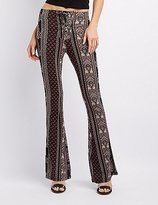 Charlotte Russe Lace-Up Printed Flare Pants