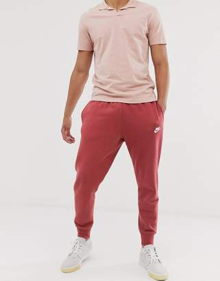 Nike Club cuffed joggers in burgundy-Red