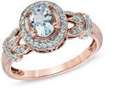 Zales Oval Aquamarine and 1/6 CT. T.W. Diamond Frame Vine Ring in 10K Rose Gold