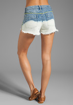 Free People Floral Embroidered Cut Offs