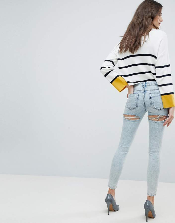 Asos DESIGN LISBON Skinny Midrise Jeans in Patience Light Wash with Bum Rips in Ankle Grazer Length
