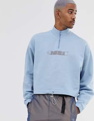 Asos Design DESIGN oversized crop sweatshirt in pale blue with NRG print