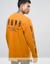 Puma Graphic Long Sleeve Top In Orange Exclusive To Asos 57533702