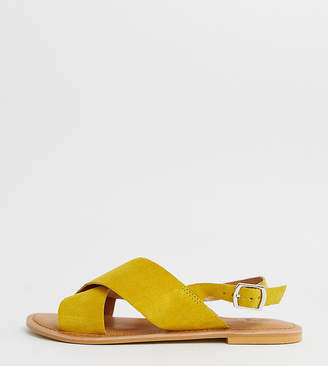Asos Design DESIGN Wide Fit Valid cross strap leather flat sandals in yellow
