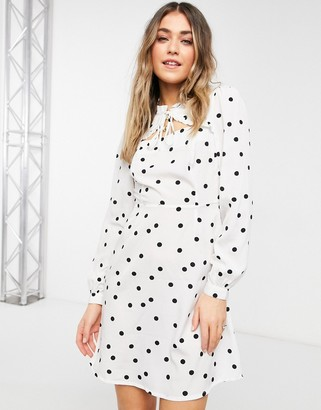 New Look tie neck ruffle detail mini dress in white polka dot