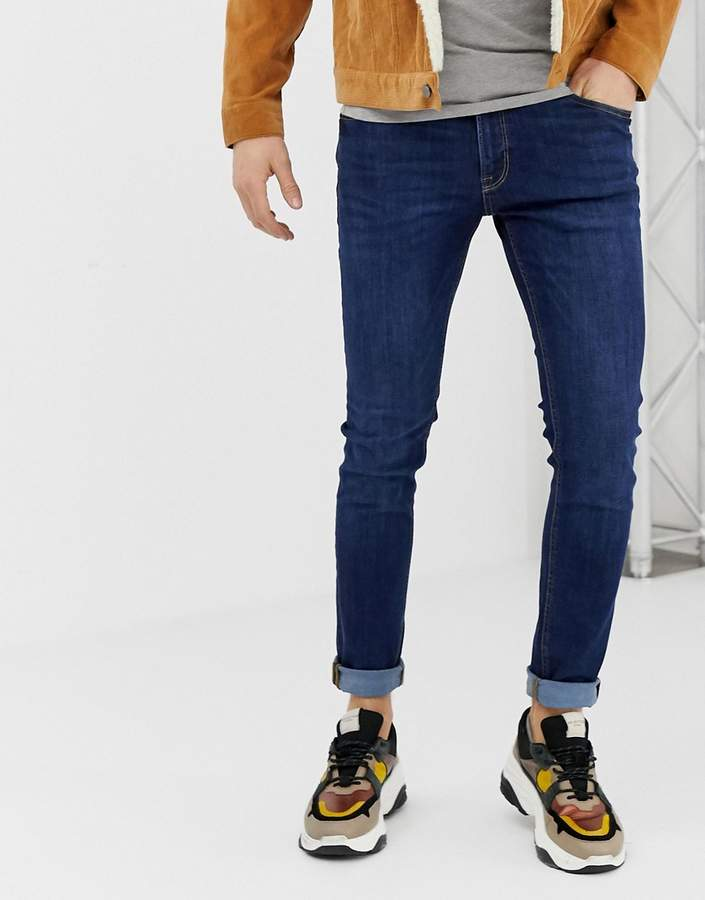 Jack and Jones Intelligence Skinny Jeans in Mid Blue Wash