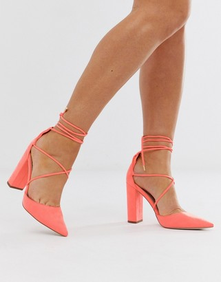 Asos DESIGN Power tie leg Trip high heels in neon pink