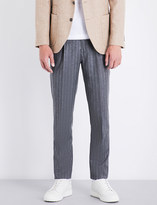 Brunello Cucinelli Pinstripe leisure-fit wool trousers