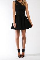 Donna Mizani Splice Flounce Dress In Black