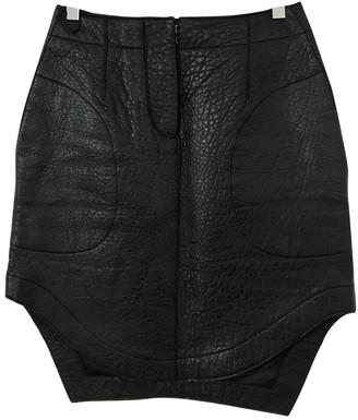 Carven Black Leather Skirts