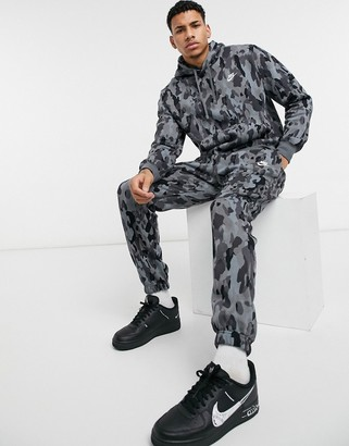 Nike Club digi camo print cuffed sweatpants in black