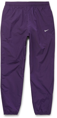 Nike Nrg Tapered Logo-embroidered Shell Track Pants - Purple