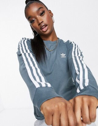 adidas adicolor three stripe long sleeve t-shirt in blue oxide