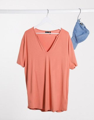 ASOS DESIGN relaxed longline t-shirt with deep v neck in viscose in brick