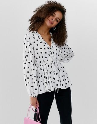 ASOS DESIGN long sleeve v neck ruffle front tea blouse with tie waist in polka dot
