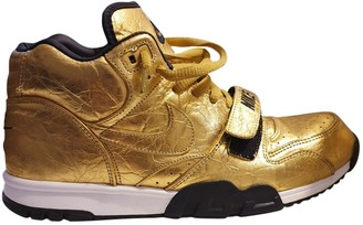 Nike Gold Leather Trainers