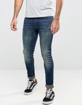 Asos Extreme Super Skinny Jeans In Dirty Dark Blue Wash