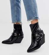 Asos DESIGN Wide Fit Ritchie western harness sock boots in black patent