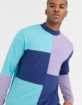 ASOS DESIGN relaxed long sleeve t-shirt with turtleneck and acid wash color block in purple