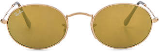 Ray-Ban Oval Flat Sunglasses in Gold Flash | FWRD