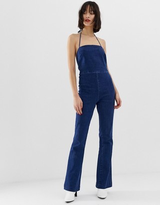 ASOS DESIGN denim flared jumpsuit with strappy back in bright blue