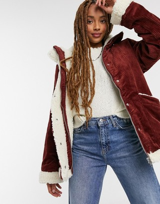 Monki Shea cord faux-shearling lined jacket in brown