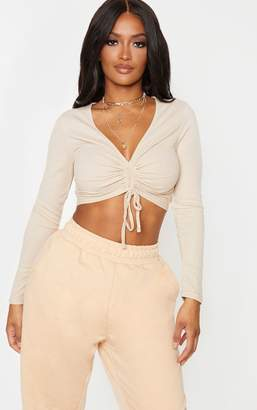 PrettyLittleThing Shape Sand Ribbed Long Sleeve Ruched Front Crop Top