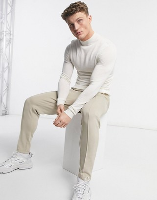 ASOS DESIGN muscle fit merino wool turtle neck jumper in white