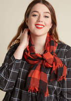 Wherever you go, this gingham scarf goes with! Intersecting red-orange and black tones take over this soft accessory, which goes above and beyond the call of a scarf by becoming a bag decoration, a pillow, or a sarong depending on your trip's needs.