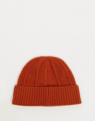 ASOS DESIGN rib knit fisherman beanie in rust
