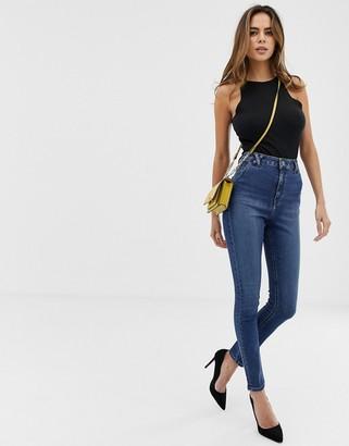 Asos Design DESIGN Ridley high waisted skinny jeans in mottled blue was with belt loop detail