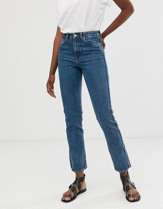 Weekday organic cotton stretch straight fit jeans with split at sides in blue