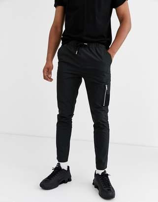 Asos Design DESIGN skinny trousers with MA1 pocket in black nylon