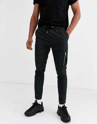 Asos DESIGN skinny trousers with MA1 pocket in black nylon