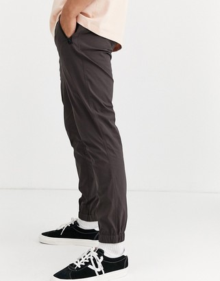 Asos DESIGN tapered woven sweatpants in nylon with webbed belt in brown