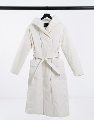Bershka longline belted padded puffer coat in ecru