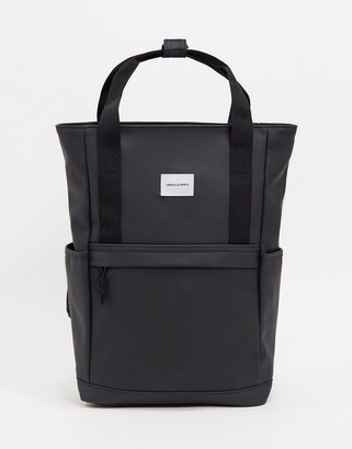 Asos DESIGN backpack in black rubberised with double strap and branded patch