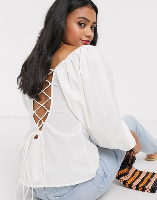 ASOS DESIGN long sleeve cotton top with lace up back detail