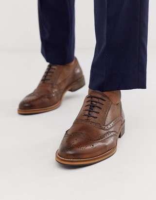 ASOS DESIGN brogue shoes in brown leather with natural sole and color details